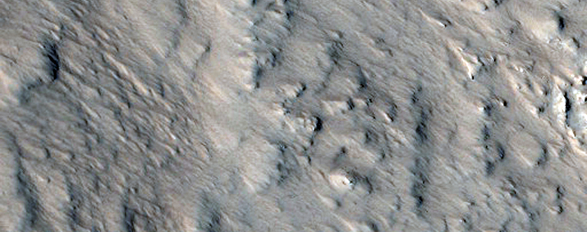 Western Portion of Well-Preserved 15-Kilometer Crater Near Alba Mons