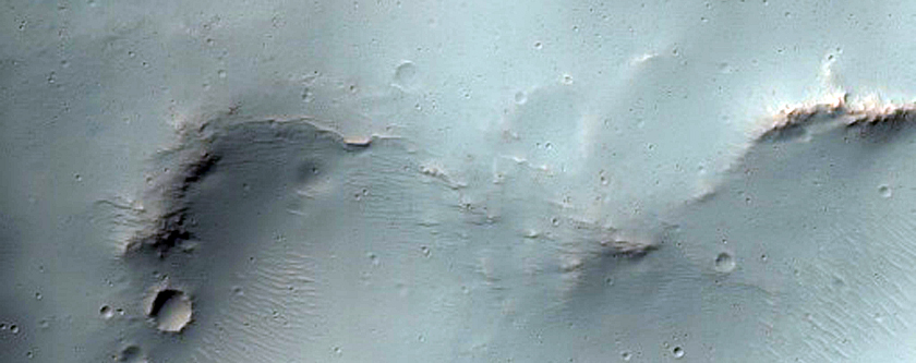 Impact with Mound Intersected with Larger Crater Rim