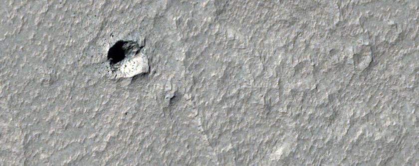 Possible Pits in Lava Flows in Daedalia Planum