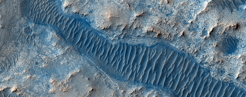 Layered Material Cut by a Valley Connected to East Jezero Crater