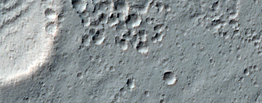 Ejecta of 6-Kilometer Diameter Rayed Crater
