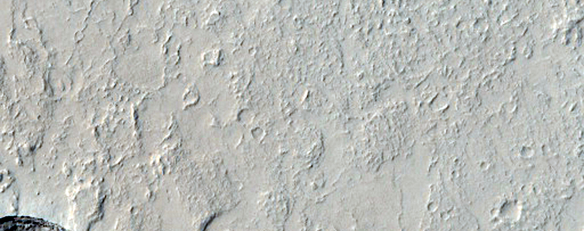 Pits and Channels in Amazonis Planitia