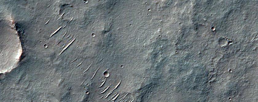 Exhumed Faults Southeast of the Thaumasia Planum
