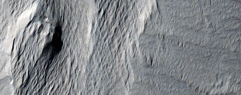 Crater Deposit Erosion in Lucus Planum