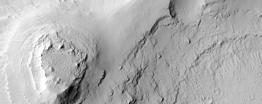 Crater with Layered Material in THEMIS Image V18397010