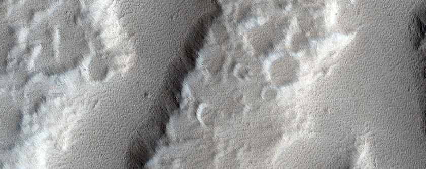 Channels and Fans along Hecates Tholus