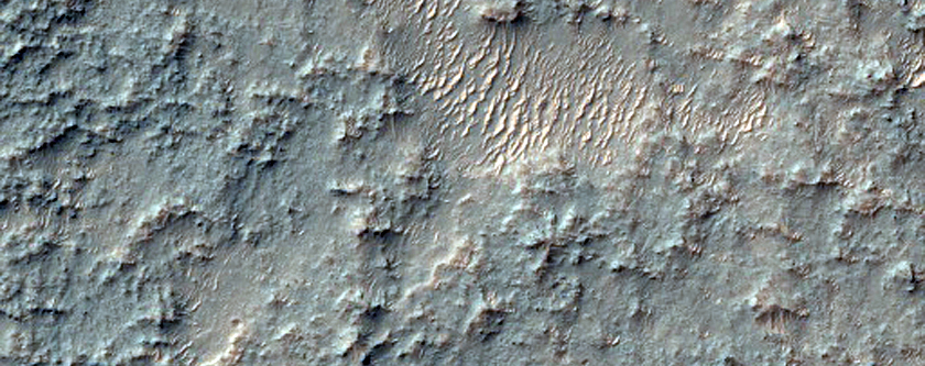 Banded Terrain and Other Features in Central Huygens Crater