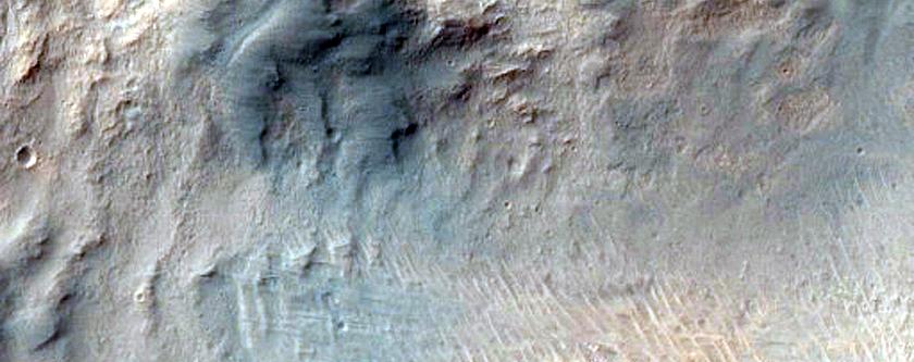 Crater on Ius Chasma Floor