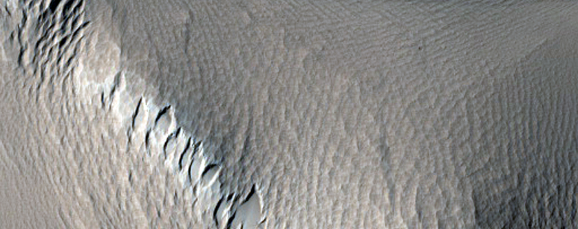 Localized Chaotic Terrain within Minio Vallis