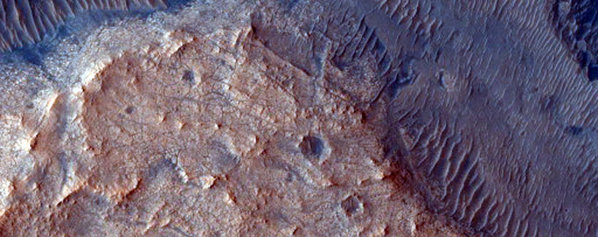 Layered Material Cut by Valley Connected to East Jezero Crater