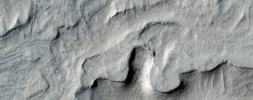 Enigmatic Pitted Uplift within a Depression in Noctis Labyrinthus