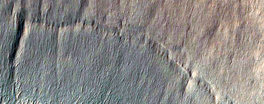 Variety of Surface Features on Crater Floor in Icaria Fossae Region