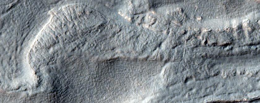 Hollowed Surface on Lobate Debris Apron in Hellas Planitia