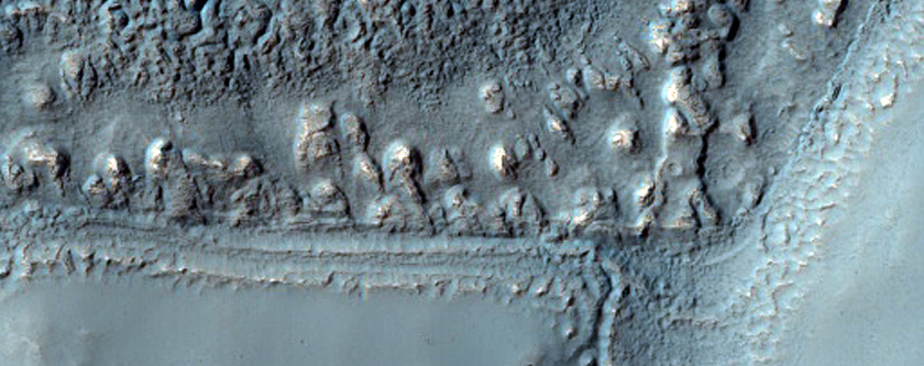 Mounds in Trough and Craters in Icaria Planum