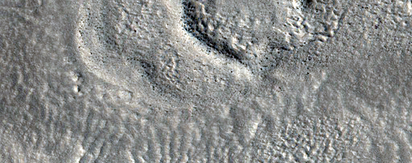 Small Valley Form in Rugged Terrain Northeast of Hecates Tholus