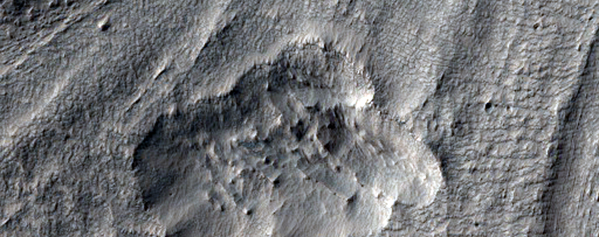 Material Flowing Through Gap in Crater Rim East of Hellas Planitia