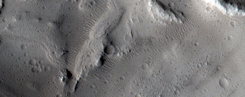 Small Crater in Tractus Catena Region