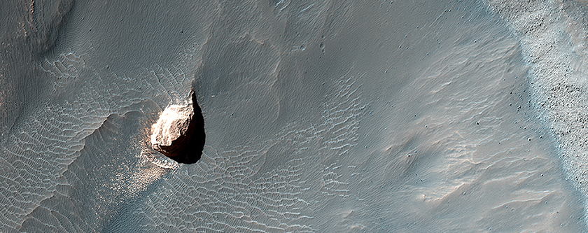 Small Crater within Pollack Crater Containing Light-Toned Material