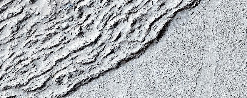 Lava against an Impact Crater in Elysium Planitia