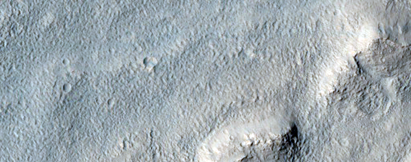 Tongue-Shaped Flow Features East of Hellas Region