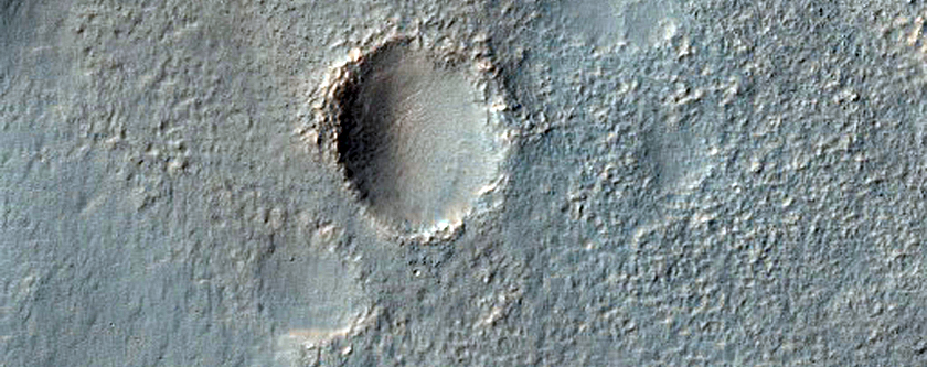 Valley Breaching Through Rim of Arkhangelsky Crater