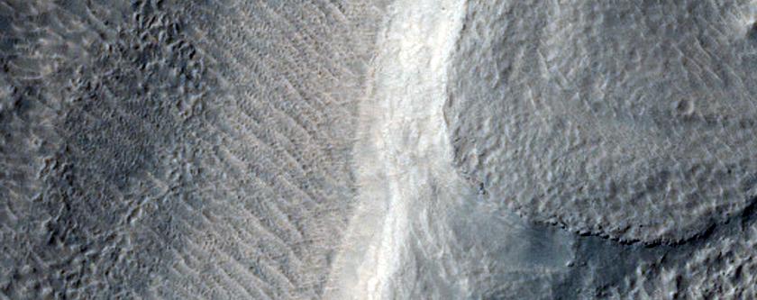 Merging Channels in Harmakhis Vallis