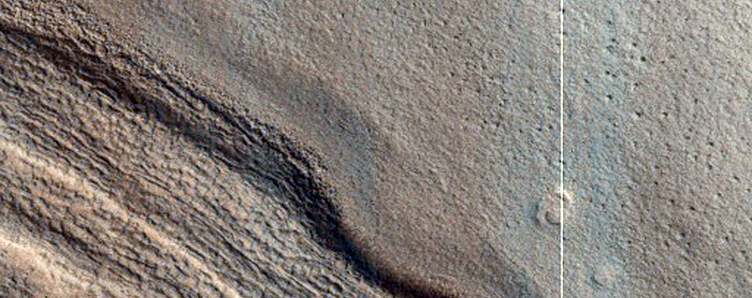 Contact between Equator-Facing Mantle and Possible Degraded Gullies