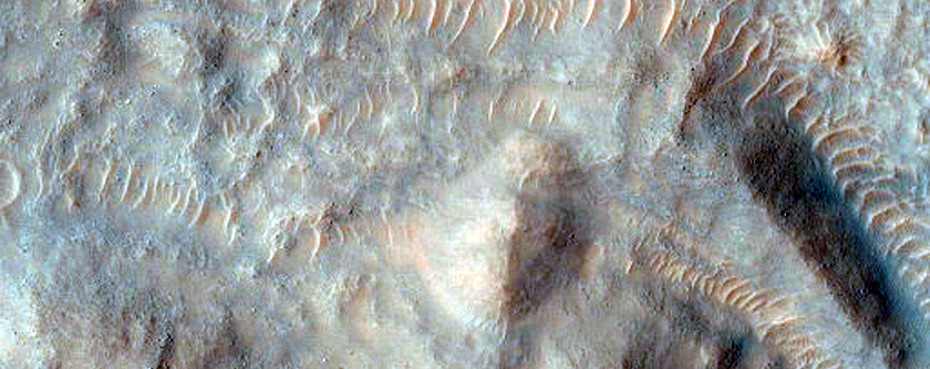 Crater with Gullies and Possible Source Layer within MOC R14-01525