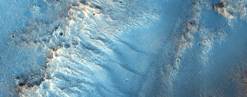 Possible Hydrated Material on Rim of Massif in Northwest Hellas Region