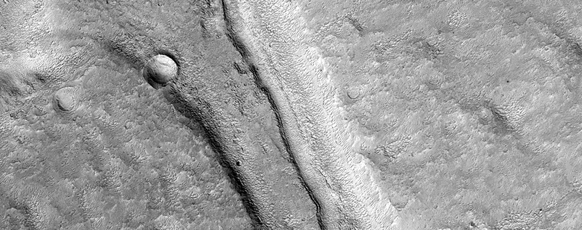 Curved Channel within Larger Channel in Northwest Arabia Terra