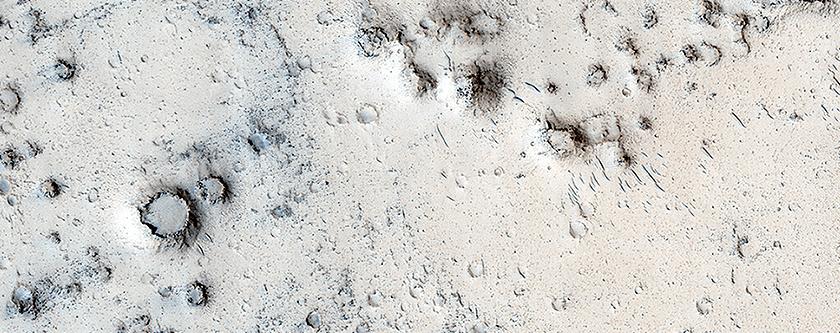 Cratered Cones in Tartarus Montes