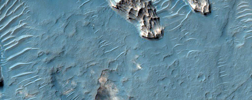 Layered Light-Toned Crater-Filling Material in Northwest Hellas Region