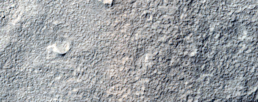 Layered Deposit in Small Crater and Wrinkle Ridge Near Reull Vallis