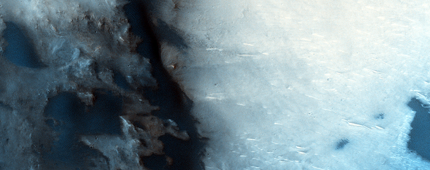 Crater with Dark Dunes and Dark Streak Emanting from Crater