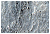 Features in  Crater in Promethei Terra
