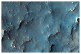 Possible Phyllosilicates in Eroded Terrain Near Channel
