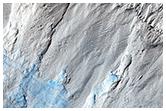 Erozja stromego stoku w rejonie warstwowanych osadów bieguna południowego