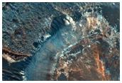 Layered Materials on Northeast Hellas Planitia Rim