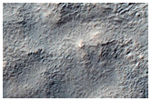 Small Pedestal Crater on Ejecta of Larger Craters