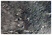 Fan-Shaped Form and Other Deposits on Crater Floor in Arabia Terra