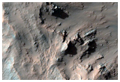 Possible Opaline Silica Excavated in the Central Uplift of Elorza Crater