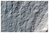 Monitor Slopes of a Crater in Terra Sirenum