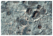 Light-Toned High Thermal Infrared Deposit on Eroded Crater Floor