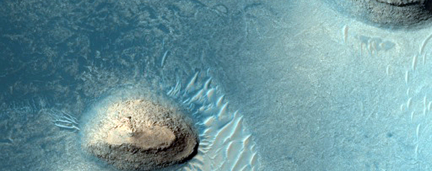 Dune Changes around Small Buttes in Meridiani Planum