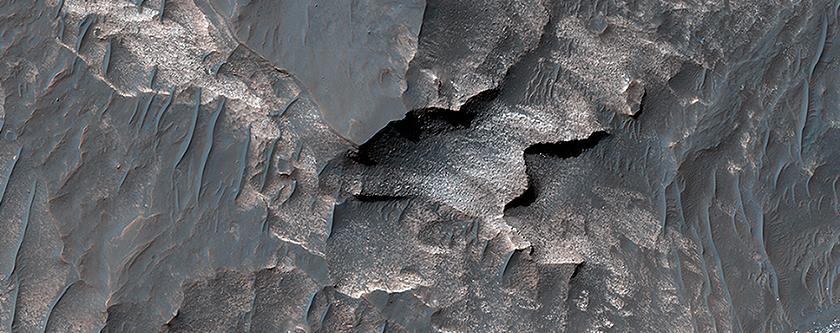 Light-Toned Deposits along Coprates Chasma Slopes