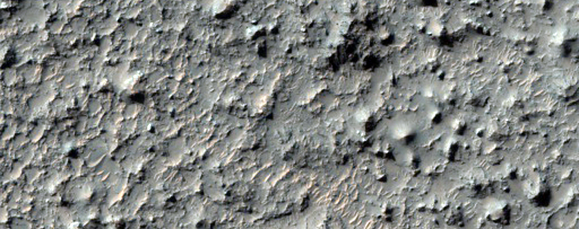 Pit on Crater Floor with Layered Material