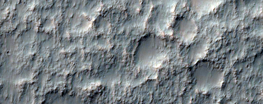 Possible Dikes on Crater Floor Near Sirenum Fossae