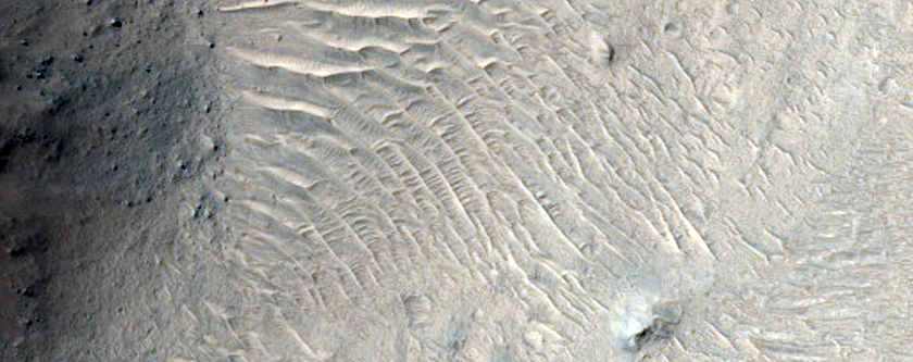 Outflow Channel Features Associated with Small Chaotic Terrain