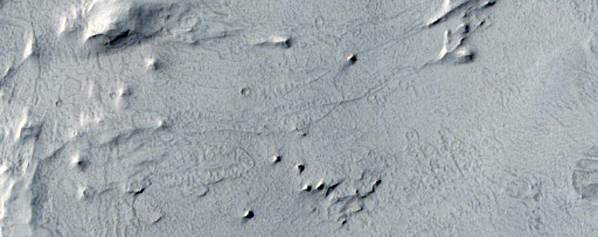 Knobby and Layered Material in Capen Crater