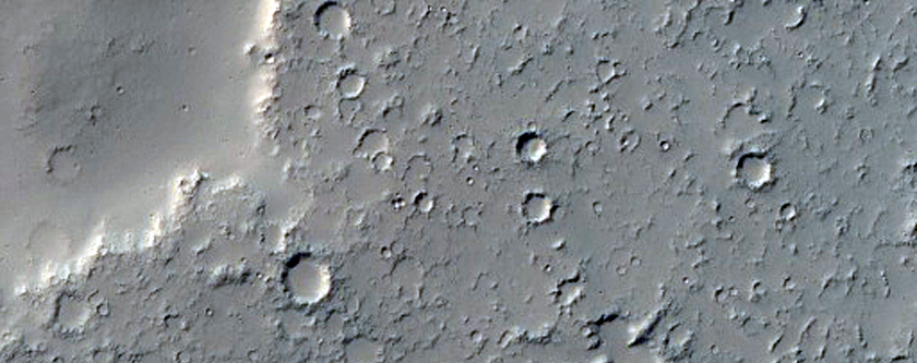 Lava Flow Spilling Over Crater Wall Onto Crater Floor in Daedalia Planum